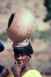 africa;african;africans;black;ethnic;people;person;persons;mother;portrait;portraits;culture;cultural;cultures;tribe;tribes;tribal;indigenous;native;woman;mali;malian;west-africa;dogon;dogons;bandiagara;pot;clay-pot;head;carry;carrying;heavy;jewellery;jewelery;jewelry;earing;earings;adorn;adornment;gold;old;elderly;lady