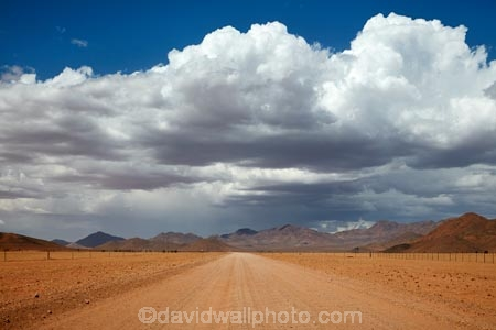 707-road;Africa;African;approaching-storm;approaching-storms;black-cloud;black-clouds;cloud;clouds;cloudy;D707-road;dark-cloud;dark-clouds;desert;deserts;dry;gravel-road;gravel-roads;gray-cloud;gray-clouds;grey-cloud;grey-clouds;metal-road;metal-roads;metalled-road;metalled-roads;Namib-Desert;Namibia;rain-cloud;rain-clouds;rain-storm;rain-storms;rainy-season;road;roads;safari;safaris;Southern-Africa;Southern-Namiba;storm;storm-cloud;storm-clouds;storms;summer;thunder-storm;thunder-storms;thunderstorm;thunderstorms;unpaved-road;unpaved-roads;weather;wet-season
