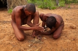 Africa;African;African-people;Bushman;Bushman-Living-Museum;Bushmanland;Bushmen;cultural;cultural-exchange;culture;demonstration;demonstrations;fire;fire-craft;fire-lighting;fire-lighting-with-sticks;Fire-making;fire-starting;fire-starting-with-sticks;fires;forager-society;Grashoek;Grashoek-Living-Museum;Grashoek-village;hunter_gatherer;Hunting-and-gathering;Ju-Hoansi_San-Living-Museum;JuHoansi;JuHoansi_San-men;JuHoansi_San-people;Living-Museum;Living-Museum-of-the-Ju-Hoansi_San;Living-Museum-of-the-JuHoansi_San;Living-Museums;making-fire;making-fires;Namibia;Namibia,-Africa;Otjozondjupa-District;Otjozondjupa-Region;people;person;rubbing-sticks-together;San;San-Living-Museum;San-people;Southern-Africa;tradition;traditional;Traditional-Bushman-Culture;traditional-clothing;traditional-costume;traditional-dress;traditional-fire-lighting;Traditional-San-Culture;tribe