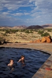 707-road;Africa;D707-road;Fest-Inn-Fels-Farm-Lodge;Fest-Inn-Fels-Lodge;Koiimasis;Koiimasis-Lodge;Namib-Desert;Namibia;people;person;pool;pools;Ranch-Koiimasis;Ranch-Koiimasis-Lodge;Southern-Africa;swim;swimmer;swimmers;swimming-pool;swimming-pools;Tiras-Mountains;Tiras-Mountains-Conservancy