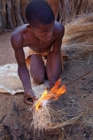 Africa;African;African-people;cultural;cultural-exchange;culture;Damara-culture;Damara-Living-Museum;Damara-Living-Village;Damara-Village;Damaraland;Damaraland-Living-Museum;demonstration;demonstrations;fire;fire-craft;fire-lighting;fire-lighting-with-sticks;Fire-making;fire-starting;fire-starting-with-sticks;fires;flame;flames;Kunene-District;Kunene-Region;Living-Museum;Living-Museums;making-fire;making-fires;Namib-Desert;Namibia;people;person;rubbing-sticks-together;Southern-Africa;tradition;traditional;traditional-clothing;traditional-costume;traditional-dress;Twyfelfontein