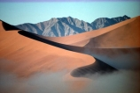 Sossusvlei;Namib_Naukluft-National-Park;national-park;Namibia;Southern-Africa;Africa;African;arid;aridity;barren;barreness;desert;deserts;deserted;empty;wilderness;solitude;sand-dune;sand-dunes;dune;dunes;sand_dune;sand_dunes;natural;nature;hot;dry;dried;remote;landscape;landscapes;desolate;desolation;ecosystem;ecosystems;loneliness;orange;red;namib;curve;curves;line;lines;misty;ripple;ripples;sand;cloud;mist;fog;low-cloud;slope;slopes;angle;sparse