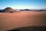wilderness-camping;safier-farm;namib-desert;namibia;namibian;africa;african;camp;camping;camper;campers;plain;plains;rock;rocks;mound;mounds;sparse;desert;deserts;deserted;arid;empty;bare;shadow;shadows;horizon;overland;overlanding;travel;vast;empty