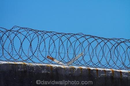 Africa;barbed-wire;barbed-wire-fence;barbed_wire;blue-sky;Cape-Town;fence;fences;gaol;gaols;island;islands;jail;jails;prison;prison-fence;prison-fences;prison-island;prisons;razor-wire;razor-wires;Robben-Island;Robben-Island-Gaol;Robben-Island-Jail;Robben-Island-Prison;Robbeneiland;S.A.;security;security-fences;South-Africa;Southern-Africa;Sth-Africa;Table-Bay;Western-Cape;Western-Cape-Province;wire;wires