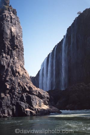 victoria-falls;zambezi-river;zambezi;zimbabwe;zambia;africa;african;southern-africa;waterfall;waterfalls;water;nature;natural;wonder-of-the-world;world-wonder;seven-natural-wonders-of-the-world;mist;misty;spary;refraction;high;power;powerful;vertical;;flow;chasm;global-warming;gush;cliff;cliffs;bluff;bluffs;crevasse;crevasses;falling;falls;fall;phenomena;phenomenon;precipice;precipices