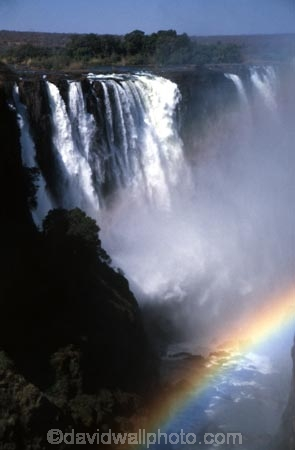 Victoria-Falls;Zambezi-River;Zimbabwe;Zambia;Africa;African;Southern-Africa;waterfall;waterfalls;water;nature;natural;wonder-of-the-world;world-wonder;seven-natural-wonders-of-the-wo;mist;misty;spary;refraction;high;power;powerful;vertical;;flow;chasm;global-warming;gush;cliff;cliffs;bluff;bluffs;crevasse;crevasses;falling;falls;fall;phenomena;phenomenon;precipice;precipices;rainbow;rainbows
