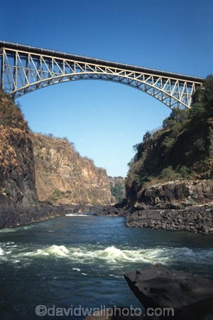 Victoria-Falls;Zambezi;Zambezi-River;Zimbabwe;Zambia;Southern-Africa;Africa;African;water;white-water;whitewater;rock;rocks;rocky;cliff;cliffs;waterfall;waterfall;tourist;tourism;tourists;travel;tour;bridge;bridges;high;tall;river;rivers;arch;canyon;canyons;gorge;gorges;batoka;batoka-gorge