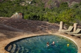 Africa;Big-Cave-Camp;Big-Cave-Lodge;camp;camps;lodge;lodges;Matobo-Hills;Matobo-National-Park;Matopos-Hills;people;person;pool;pools;resort;resorts;Southern-Africa;swim;swimmer;swimmers;swimming-pool;swimming-pools;Zimbabwe