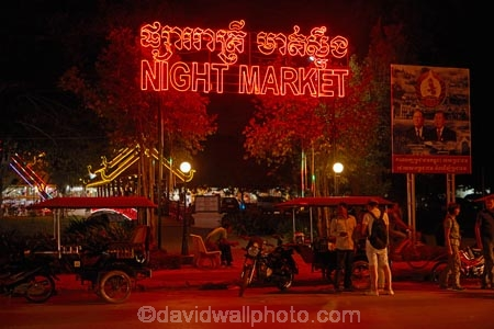 Asia;Auto-rickshaw;Auto-rickshaws;Cambodia;commerce;commercial;craft-market;craft-markets;Curio-and-Handcraft-Market;Curio-and-Handicraft-Market;curio-market;curio-markets;dark;dusk;evening;handcraft;Handcraft-Market;Handcraft-Markets;handcrafts;handicraft;Handicraft-Market;Handicraft-Markets;handicrafts;Indochina-Peninsula;Kampuchea;Kingdom-of-Cambodia;light;lighting;lights;market;market-place;market-stall;market-stalls;market_place;marketplace;marketplaces;markets;motorcycle-taxi;motorcycle-taxis;motorized-rickshaw;motorized-rickshaws;neon-light;neon-lights;night;night-market;night-markets;night-time;night_time;people;person;retail;retailer;retailers;shop;shopping;shops;Siem-Reap;Siem-Reap-Province;Southeast-Asia;souvenir;souvenir-market;souvenir-markets;souvenirs;stall;stalls;steet-scene;street-scenes;three_wheeler;three_wheelers;tourism;tourist;tourist-market;tourist-markets;tourists;tuk-tuk;tuk-tuks;tuk_tuk;tuk_tuks;tuktuk;tuktuks;twilight;wood-carving;wood-carvings