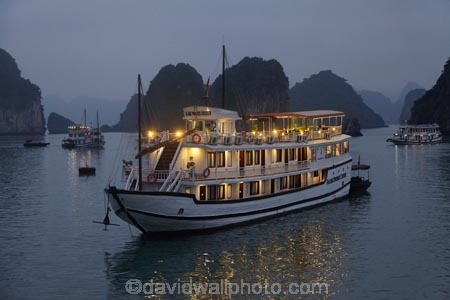 Asia;boat;boats;calm;cruise-boat;cruise-boats;cruising;dusk;evening;Ha-Long-Bay;Halong-Bay;Halong-Phoenix-Boat;Halong-Phoenix-Cruiser-Boat;Halong-Phoenix-Cruiser-Tour-Boat;karst-landscape;light;lighting;lights;limestone-karsts;night;nightfall;North-Vietnam;Northern-Vietnam;placid;Qung-Ninh-Province;Quang-Ninh-Province;quiet;reflected;reflection;reflections;serene;smooth;South-East-Asia;Southeast-Asia;still;tour-boat;tour-boats;tourism;tourist;tourist-boat;tourist-boats;tourists;tranquil;travel-destination;UN-world-heritage-area;UN-world-heritage-site;UNESCO-World-Heritage-area;UNESCO-World-Heritage-Site;united-nations-world-heritage-area;united-nations-world-heritage-site;Vnh-H-Long;Vietnam;Vietnamese;water;world-heritage;world-heritage-area;world-heritage-areas;World-Heritage-Park;World-Heritage-site;World-Heritage-Sites