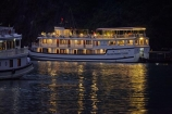 Asia;boat;boats;calm;cruise-boat;cruise-boats;cruising;dusk;evening;Ha-Long-Bay;Halong-Bay;Halong-Phoenix-Boat;Halong-Phoenix-Cruiser-Boat;Halong-Phoenix-Cruiser-Tour-Boat;light;lighting;lights;night;nightfall;North-Vietnam;Northern-Vietnam;placid;Qung-Ninh-Province;Quang-Ninh-Province;quiet;reflected;reflection;reflections;serene;smooth;South-East-Asia;Southeast-Asia;still;tour-boat;tour-boats;tourism;tourist;tourist-boat;tourist-boats;tourists;tranquil;travel-destination;UN-world-heritage-area;UN-world-heritage-site;UNESCO-World-Heritage-area;UNESCO-World-Heritage-Site;united-nations-world-heritage-area;united-nations-world-heritage-site;Vnh-H-Long;Vietnam;Vietnamese;water;world-heritage;world-heritage-area;world-heritage-areas;World-Heritage-Park;World-Heritage-site;World-Heritage-Sites