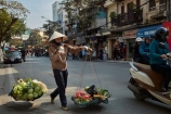 Asia;Asian;carrying-pole;carrying-stick;fresh-produce;fruit;hanging-basket;hanging-baskets;Hanoi;hawker;hawkers;milkmaids-yoke;Old-Quarter;produce;South-East-Asia;Southeast-Asia;street;street-scene;street-scenes;street-vendor;street-vendors;streets;vegetable;vegetables;vendor;vendors;Vietnam;Vietnamese;yoke;yokes