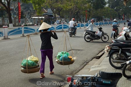 Asian;Asian-conical-hat;Asian-conical-hats;bamboo-yoke;bamboo-yokes;bike;bikes;carrying-pole;carrying-poles;carrying-stick;carrying-sticks;commerce;commercial;conical-hat;conical-hats;Hu;Hue;leaf-hat;leaf-hats;market;market-place;market-stall;market-stalls;market_place;marketplace;marketplaces;markets;milkmaid-yoke;milkmaid-yokes;motorbike;motorbikes;motorcycle;motorcycles;motorscooter;motorscooters;non-la;North-Central-Coast;nón-lá;palm_leaf-conical-hat;people;person;retail;retailer;retailers;scooter;scooters;shop;shopping;shops;stall;stalls;step_through;step_throughs;street;street-scene;street-scenes;streets;Tha-Thiên_Hu-Province;Thua-Thien_Hue-Province;Vietnam;Vietnamese;Vietnamese-conical-hat;Vietnamese-conical-hats;Vietnamese-hat;Vietnamese-hats;Vietnamese-symbol;woman;women;yoke;yokes;Asia