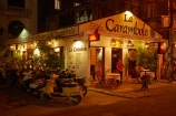 bar;bars;cafe;cafes;coffee-shop;coffee-shops;dark;diner;diners;dining;dining-out;dusk;evening;Hu;Hue;La-Carambole-French-Restaurant;La-Carambole-Restaurant;light;lighting;lights;night;night-time;night_time;North-Central-Coast;restaurant;restaurants;street;street-scene;street-scenes;streets;Tha-Thiên_Hu-Province;Thua-Thien_Hue-Province;twilight;Vietnam;Vietnamese;Asia