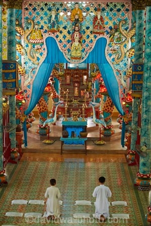 Asia;Asian;Cai-Ly;Cai-Lay;Cai-Lay-town;Cao-Dai-religion;Cao-Dai-Temple;Cao-Ðài;Caodaism;Caodaist;Caodaists;devotee;devotees;faith;inside;interior;interiors;Mekong-Delta;ornamental;people;person;place-of-worship;places-of-worship;pray;praying;religion;religions;religious;South-East-Asia;Southeast-Asia;temple;temples;Tien-Giang-province;Vietnam;Vietnamese