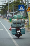 Asia;Asian;bike;bikes;Mekong-Delta;Mekong-Delta-Region;motorbike;motorbikes;motorcycle;motorcycles;motorscooter;motorscooters;My-Tho;over_load;over_loaded;overload;overloaded;scooter;scooters;South-East-Asia;Southeast-Asia;step_through;step_throughs;Tin-Giang-Province;Tien-Giang-Province;Vietnam;Vietnamese
