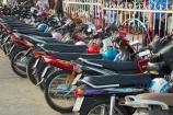 Asia;Asian;bike;bikes;Cn-Tho;Can-Tho;Can-Tho-City;Mekong-Delta;Mekong-Delta-Region;motorbike;motorbikes;motorcycle;motorcycles;motorscooter;motorscooters;row;rows;scooter;scooters;South-East-Asia;Southeast-Asia;step_through;step_throughs;Vietnam;Vietnamese