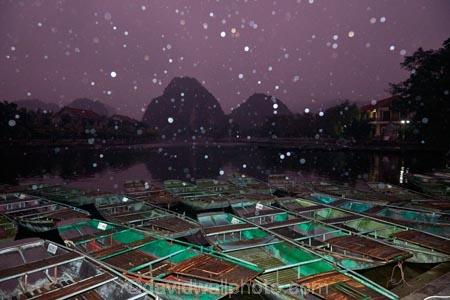 Asia;boat;boat-harbors;boat-harbour;boats;dark;dock;docks;dusk;evening;karst-topography;karsts;limestone-karst;limestone-karsts;limestone-landscape;Ngo-Dong-River;night;night-time;night_time;Ninh-Binh;Ninh-Bình-province;Ninh-Hai;Northern-Vietnam;punt;punts;rain;raining;rainy;Red-River-Delta;river;rivers;row-boat;row-boats;South-East-Asia;Southeast-Asia;Tam-Coc;Tan-Coc;Three-Caves;tourism;tourist;tourist-boat;tourist-boats;tourists;UN-world-heritage-area;UN-world-heritage-site;UNESCO-World-Heritage-area;UNESCO-World-Heritage-Site;united-nations-world-heritage-area;united-nations-world-heritage-site;Van-Lam-Village;Vietnam;Vietnamese;water;world-heritage;world-heritage-area;world-heritage-areas;World-Heritage-Park;World-Heritage-site;World-Heritage-Sites