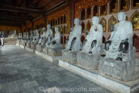 alabaster;Arhat;Arhats;Asia;Bai-Dinh-Buddist-Temple;Bai-Dinh-Mountain;Bai-Dinh-Temple;Bai-Dinh-Temple-Spiritual-and-Cultural-Complex;Buddhist-Temple;Buddhist-Temples;Buddism;Buddist;Chua-Bai-Dinh;cloister;cloisters;corridor;corridors;Gai-Vien-District;gold;hall;halls;man;marble;men;Ninh-Binh;Ninh-Binh-Province;Ninh-Bình-province;Northern-Vietnam;people;person;place-of-worship;places-of-worship;pray;prayer;praying;religion;religions;religious;South-East-Asia;Southeast-Asia;statue;statues;stone;stone-statues;temple;temples;Vietnam;Vietnamese