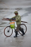 Asia;bicycle;bicycles;bike;bikes;cycle;cycler;cyclers;cycles;cyclist;cyclists;Ninh-Binh;Ninh-Bình-province;Ninh-Hai;Northern-Vietnam;people;person;push-bike;push-bikes;push_bike;push_bikes;pushbike;pushbikes;rain;raining;rainy;South-East-Asia;Southeast-Asia;street;street-scene;street-scenes;streets;Van-Lam-Village;Vietnam;Vietnamese