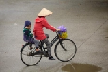 Asia;Asian-conical-hat;Asian-conical-hats;bicycle;bicycles;bike;bikes;child;children;conical-hat;conical-hats;cycle;cycler;cyclers;cycles;cyclist;cyclists;leaf-hat;leaf-hats;Ninh-Binh;Ninh-Bình-province;Ninh-Hai;non-la;Northern-Vietnam;nón-lá;palm_leaf-conical-hat;people;person;push-bike;push-bikes;push_bike;push_bikes;pushbike;pushbikes;rain;raining;rainy;South-East-Asia;Southeast-Asia;street;street-scene;street-scenes;streets;Van-Lam-Village;Vietnam;Vietnamese;Vietnamese-conical-hat;Vietnamese-conical-hats;Vietnamese-hat;Vietnamese-hats;Vietnamese-symbol;woman;women