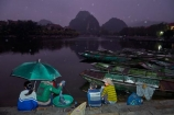 Asia;boat;boat-harbors;boat-harbour;boats;dark;dock;docks;dusk;evening;karst-topography;karsts;limestone-karst;limestone-karsts;limestone-landscape;Ngo-Dong-River;night;night-time;night_time;Ninh-Binh;Ninh-Bình-province;Ninh-Hai;Northern-Vietnam;people;person;punt;punts;rain;raining;rainy;Red-River-Delta;river;rivers;row-boat;row-boats;South-East-Asia;Southeast-Asia;Tam-Coc;Tan-Coc;Three-Caves;tourism;tourist;tourist-boat;tourist-boats;tourists;UN-world-heritage-area;UN-world-heritage-site;UNESCO-World-Heritage-area;UNESCO-World-Heritage-Site;united-nations-world-heritage-area;united-nations-world-heritage-site;Van-Lam-Village;Vietnam;Vietnamese;water;world-heritage;world-heritage-area;world-heritage-areas;World-Heritage-Park;World-Heritage-site;World-Heritage-Sites