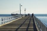 australasia;Australia;australian;coast;coastal;coastline;fisher;fisherman;fishermen;fishers;fisherwoman;fisherwomen;fishing;Fraser-Coast;Hervey-Bay;jetties;jetty;orange;people;person;pier;piers;queensland;ray;rays;Urangan-pier;walk;wharf;wharfs;wharves