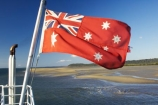 australasia;Australia;australian;Australian-Red-Ensign;blow;blowing;cruise;ferries;ferry;Flag;flags;flutter;Fraser-Island;great-sandy-n.p.;great-sandy-national-park;great-sandy-np;icon;icons;Maritime;maritime-flag;Queensland;red-ensign;star;stars;symbol;symbols;union-jack;wind;windy