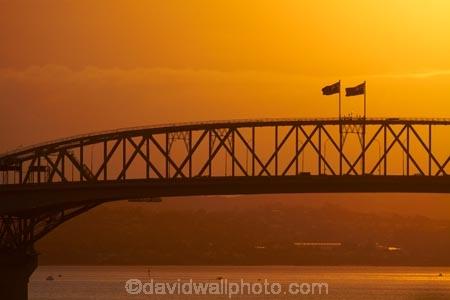 Auckland;Auckland-Harbour-Bridge;bridge;bridges;dusk;evening;flag;flags;infrastructure;N.I.;N.Z.;New-Zealand;NI;nightfall;North-Is.;North-Island;Nth-Is;NZ;orange;road-bridge;road-bridges;silhouette;silhouettes;sky;span;spans;steel;structure;structures;sunset;sunsets;traffic-bridge;traffic-bridges;transport;transportation;twilight;Waitemata-Harbor;Waitemata-Harbour