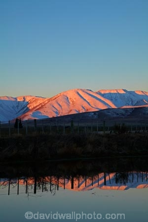 alpenglo;alpenglow;alpine;alpinglo;alpinglow;calm;Central-Otago;cold;Coldness;color;colors;colour;colours;dusk;evening;extreme-weather;fence;fence-line;fence-lines;fence_line;fence_lines;fenceline;fencelines;fences;freeze;freezing;Hawkdun-Ra;Hawkdun-Range;Hills-Creek;Ida-Ra;Ida-Range;Ida-Rd;Ida-Valley;Idaburn;irrigation-pond;Maniototo;mountain;mountainous;mountains;mt;N.Z.;New-Zealand;night;night_time;nightfall;NZ;Otago;Oturehua;placid;pond;ponds;quiet;reflected;reflection;reflections;S.I.;Scenic;Scenics;Season;Seasons;serene;SI;smooth;snow;snowy;South-Is;South-Island;Sth-Is;still;sunset;sunsets;tranquil;twilight;water;weather;white;winter;Wintertime;wintery;wintry