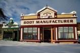 boot-manufacturer;boot-manufacturers;building;buildings;Central-Otago;clock;clocks;clothier;clothiers;cold;Coldness;Daytime;draper;drapers;Exterior;extreme-weather;freeze;freezing;heritage;high-country;historic;historic-building;historic-buildings;historic-shop;historic-shops;historical;historical-building;historical-buildings;history;Hjorring;I.N.P.-Hjorring,-Draper-amp;-Clothier,;Landscape;Landscapes;Maniototo;N.Z.;Nasby-Museum;Naseby;natural;Nature;New-Zealand;NZ;old;Otago;Outdoor;Outdoors;Outside;S.I.;Scenic;Scenics;Season;Seasons;shop;shops;SI;snow;snowfall;snowy;South-Is;South-Is.;South-Island;Sth-Is;Strongs-Watchmaker-Shop;Strong's-Watchmaker-Shop;tradition;traditional;Watchmaker-Shop;weather;White;winter;Wintertime;wintery;wintry