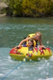 adventure;b1a5114;bannockburn;biscuiting;central;Central-Otago;child;children;dunstan;exciting;exhilaration;fast;fun;girl;girls;happy;hot;inflatable-tube;inner-tube;inner-tubing;inner_tubing;island;lake;Lake-Dunstan;lakes;leisure;N.Z.;new;new-zealand;NZ;otago;play;playing;recreation;S.I.;SI;south;South-Is;South-Is.;South-Island;speed;summer;Summertime;teenager;teenagers;thrill;Thrilling;tube;tubing;water;water-biscuit;water-sport;water-sports;watersport;watersports;wet;zealand