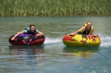 adventure;b1a5238;bannockburn;biscuiting;central;Central-Otago;dunstan;exciting;exhilaration;fast;fun;girl;girls;happy;hot;inflatable-tube;inner-tube;inner-tubing;inner_tubing;island;lake;Lake-Dunstan;lakes;leisure;N.Z.;new;new-zealand;NZ;otago;play;playing;recreation;S.I.;SI;south;South-Is;South-Is.;South-Island;speed;summer;Summertime;teenager;teenagers;thrill;Thrilling;tube;tubing;water;water-biscuit;water-sport;water-sports;watersport;watersports;wet;zealand