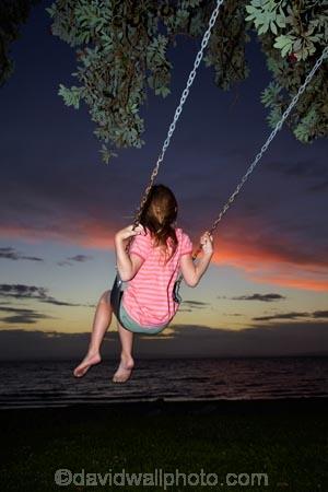 10-year-old;10-years-old;9-year-old;9-years-old;child;children;coast;coastal;Coromandel;Coromandel-Peninsula;dusk;evening;fill-flash;fill_flash;fillflash;Firth-of-Thames;fun;girl;girls;happy;joy;kid;kids;kiwi-icon;kiwi-icons;kiwiana;little-girl;little-girls;N.I.;N.Z.;New-Zealand;NI;nightfall;nine-year-old;nine-years-old;North-Is;North-Is.;North-Island;NZ;orange;outdoor;outside;people;person;play;playing;Pohutukawa-Tree;Pohutukawa-Trees;rope-swing;rope-swings;shore;sky;summer;sunset;sunsets;swing;swinging;swings;Tararu;ten-year-old;ten-years-old;Thames;Thames-Coast;twilight;Waikato;young-girl;young-girls