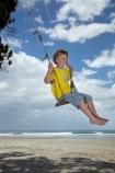 7-year-old;7-years-old;8-year-old;8-years-old;beach;beaches;boy;boys;child;children;coast;coastal;Coromandel;Coromandel-Peninsula;eight-year-old;eight-years-old;fun;happy;joy;kid;kids;kiwi-icon;kiwi-icons;kiwiana;little-boy;little-boys;N.I.;N.Z.;New-Zealand;NI;North-Is;North-Is.;North-Island;NZ;outdoor;outside;people;person;play;playing;Pohutukawa-Tree;Pohutukawa-Trees;rope-swing;rope-swings;seven-year-old;seven-years-old;shore;summer;swing;swinging;swings;Waihi-Beach;Waikato;young-boy;young-boys