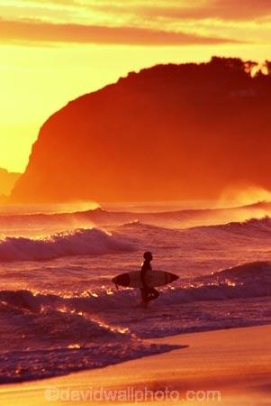 beaches;dusk;last-light;ocean;orange;pacific;sand;sea;surf;surf-board;surfers;wave;waves
