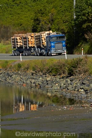 articulated-lorries;articulated-lorry;articulated-truck;articulated-trucks;bulk;calm;Dunedin;Dynes-Transport;Dynes-Transport;export;export-logs;exporting;exports;forestry;forestry-industry;heavy-haulage;industrial;industry;Juggernaut;Juggernauts;Kenworth;Kenworths;log;log-hauler;log-haulers;log-lorries;log-lorry;log-truck;log-trucks;logging;logging-lorries;logging-lorry;logging-truck;logging-trucks;logs;lorries;lorry;lumber;N.Z.;New-Zealand;NZ;Otago;Otago-Harbour;pine;pine-tree;pine-trees;pines;pinus-radiata;placid;Port-Chalmers;Pt-Chalmers;quiet;Ravensbourne-Rd;Ravensbourne-Road;reflected;reflection;reflections;rig;rigs;S.I.;semi;semitrailer;semitrailers;serene;SI;smooth;South-Is;South-Is.;South-Island;St-Leonards;Sth-Is;still;stockpile;stockpiles;timber;timber-industry;tractor-trailer;tractor-trailers;trade;tranquil;transport;transportation;tree;tree-trunk;tree-trunks;trees;truck;trucks;water;wood