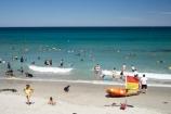 beach;beaches;coast;coastal;coastline;crowd;crowds;Dunedin;flags;fun;hot;inflatable-rubber-boat;inflatable-rubber-boats;irb;leisure;N.Z.;New-Zealand;NZ;ocean;oceans;Otago;people;play;rescue-boat;rescue-boats;S.I.;Saint-Clear-Beach;sand;sandy;sea;seas;shore;shoreline;SI;South-Is.;South-Island;St-Clair-Beach;St.-Clair-Beach;summer;summertime;surf-lifesaving-flag;swimmers;swimming