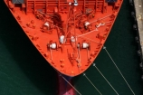 ship;bow;rope;ropes;dock;docked;docking;orange;red