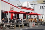 alfresco;bar;bars;cafe;cafes;corrugated-iron;corrugated-steel;cuisine;dine;diner;diners;dining;eat;eating;food;Hawkes-Bay;hotel;hotels;leisure;lunch;N.I.;N.Z.;Napier;New-Zealand;NI;North-Island;NZ;outdoor-dining;outdoors;outdoors-dining;outside;outside-dining;patron;patrons;people;person;relaxing;restaurant;restaurants;Shed-2;Shed-Two;sun-umbrella;sun-umbrellas;tavern;taverns;West-Quay
