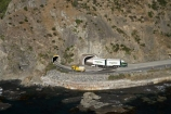 aerial;aerial-photo;aerial-photography;aerial-photos;aerial-view;aerial-views;aerials;articulated-truck;articulated-trucks;bluff;bluffs;cliff;cliffs;coast;coastal;coastline;coastlines;coasts;driving;highway;highways;Kaikoura;Kaikoura-Coast-Road;lorries;lorry;Marlborough;N.Z.;New-Zealand;NZ;ocean;open-road;open-roads;Parititahi-Tunnel;Parititahi-Tunnels;road;road-trip;road-tunnel;road-tunnels;roads;rugged;S.I.;sea;Seaward-Kaikoura-Range;Seaward-Kaikoura-Ranges;shore;shoreline;shorelines;shores;SI;South-Island;State-Highway-1;State-Highway-one;steep;transport;transportation;travel;traveling;travelling;trip;truck;trucks;tunnel;tunnels;water