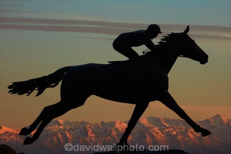 alpenglo;alpenglow;alpine;alpinglo;alpinglow;art;art-work;art-works;break-of-day;bronze-sculpture;bronze-statue;Canterbury;color;colors;colour;colours;dawn;dawning;daybreak;equestrian;first-light;horse;horse-racing;horse-statue;horse-statues;horses;jockey-Jim-Pike;morning;mountain;mountainous;mountains;mt;N.Z.;New-Zealand;NZ;orange;Phar-Lap;Phar-Lap-Raceway;Phar-Lap-Statue;public-art;public-art-work;public-art-works;public-sculpture;public-sculptures;S.I.;sculptor-Joanne-Sullivan_Giessler;sculpture;sculptures;SI;snow;South-Canterbury;South-Is;South-Is.;South-Island;statue;statues;Sth-Is;sunrise;sunrises;sunup;Timaru;twilight;Washdyke
