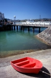 cement;color;colour;concrete;dingys;dock;docked;harbor;harbour;orange;ramp;red;rowboat;water