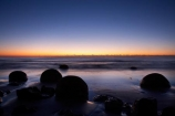 beach;beaches;boulder;break-of-day;calm;coast;coastal;coastline;coastlines;coasts;concretion;dawn;dawning;daybreak;first-light;formation;geological;geology;marble;marbles;Moeraki;Moeraki-Boulder;Moeraki-Boulders;morning;N.Z.;New-Zealand;North-Otago;NZ;ocean;Otago;placid;quiet;reflection;reflections;rock;rocks;round;S.I.;sand;sea;sedementary;serene;shore;shoreline;shorelines;shores;SI;smooth;South-Island;sphere;still;sunrise;sunrises;sunup;tranquil;twilight;Waikati-District;Waitaki-District;water