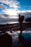 walks;tramper;tramping;tramp;pack;backpack;hiker;hike;hiking;beach;beaches;godrays;god_rays;god-rays;clouds;overcast;light;dusk;grey;water;sea;sea-water;seawater;rocks;reflections;reflection;outline;silhouette;light;dark;darkness