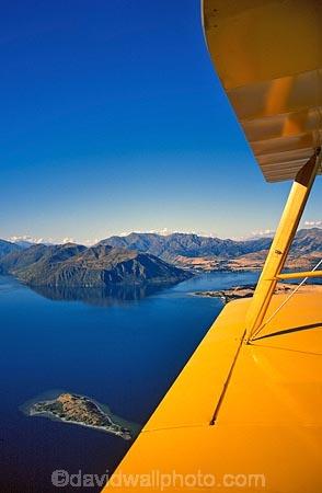 aerial;aerials;aeroplane;aeroplanes;plane;planes;wing;plane-wing;yellow;yellow-wing;yellow-plane;yellow-aeroplane;water;still;lake-wanaka;tiger-moth;biplane;bi-plane;bi_plane;history;historical