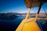plane;aeroplane;planes;aeroplanes;airplane;airplanes;fly;flying;vintage;old;historic;historical;lakes;biplanes;aviation;aircraft;aircrafts;flight;flights;sky;pilot;pilots;open;cockpit;cockpits;tiger_moth;tigermoth;tigermoths;tiger_moths;tiger-moths;wing;wings;strut;struts;mountain;mountains;color;colors;colours;colour;blue;yellow