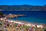 beach;beaches;picnics;picnic;summer;recreation;relaxation;sailing;boat;boats;boating;leisure;sun;sunbathe;swim;swimming;coast;coastline;shore;shoreline;sunbathers;sunbathing;bays;surf;tide