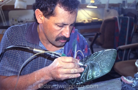 art;artwork;carving;concentrate;concentration;create;creating;creation;creative;detail;details;drill;drilling;drills;industry;maori;Ngai-Tahu;tourism;work;working;workshop