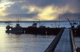 boat;boats;color;colors;colour;colours;dusk;harbor;harbors;harbour;harbours;moor;moored;mooring;peaceful;pier;setting;silhouette,tranquil;sun;sunset